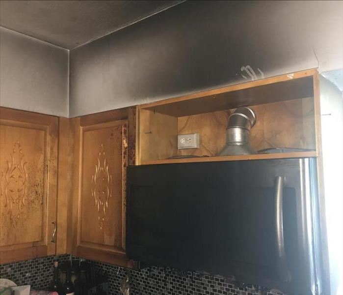 Dark discoloration on wall in kitchen from smoke damage as a result of a kitchen fire.