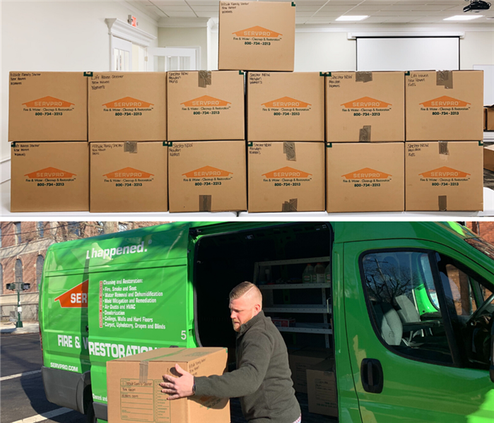 Servpro boxes filled with coat donations, and Servpro marketer unloading donation boxes from Servpro van