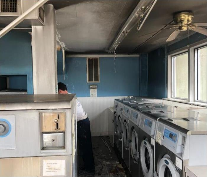 soot and smoke covering walls and floors after tv fire in laundromat