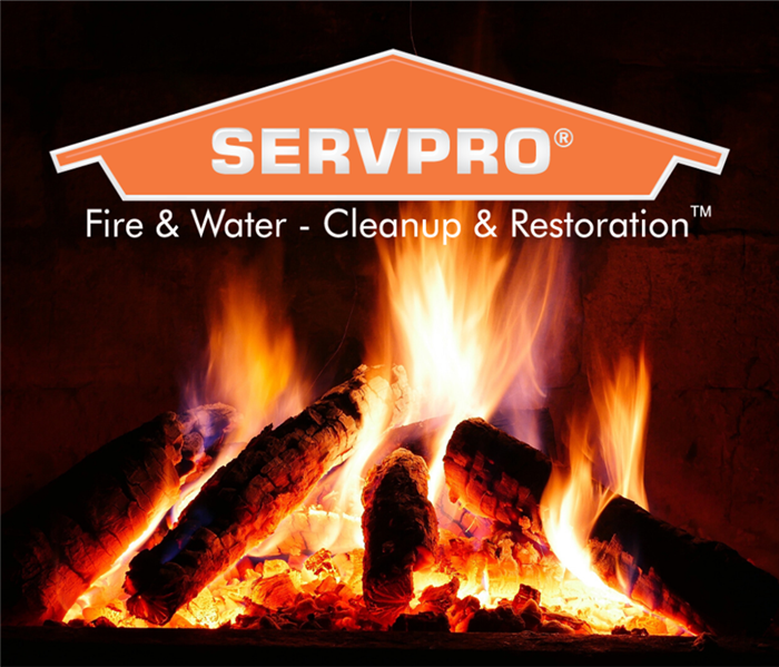 Burning wood in fire place with SERVPRO logo over it