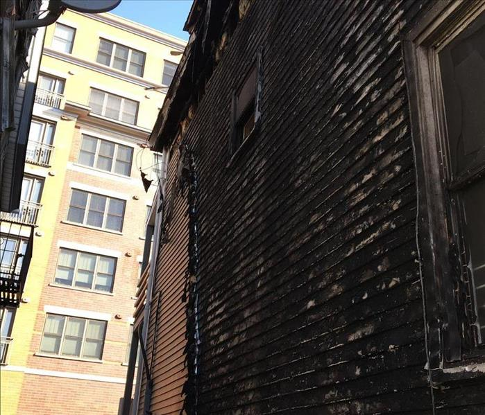 fire damage on the side of a house